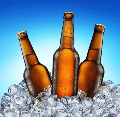 Three Beer Bottles sitting in ice